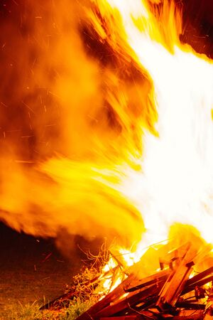 incandescence: Camp fire in the night fire, background, camp, embers, flaming, nobody, yellow, night, orange, fiery, campfire, light, incandescence, black, energy, flame, wood, texture, illumination, ashes, smoke, sparks, flames, detail, vacation, hot, fuel, isolated, a