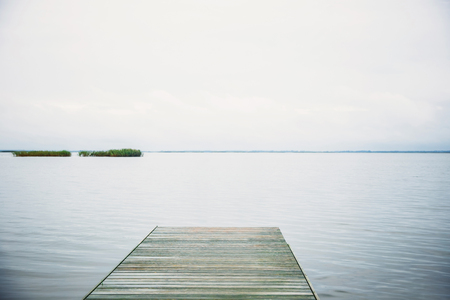 Wooden boat dock in the lake