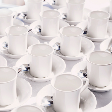 White empty cups arranged on the table