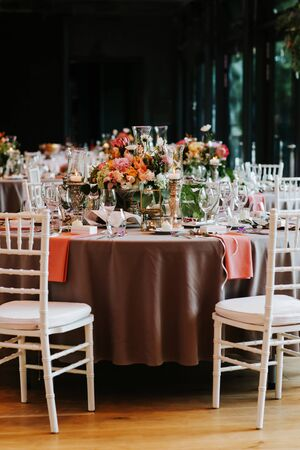 Beautiful, decorated table with flower decorations. Wedding or party decorations.