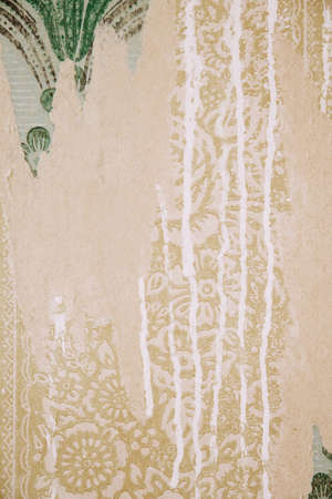 Vintage, old wallpaper, dripping paint, layers of different colorful paper backgrounds.