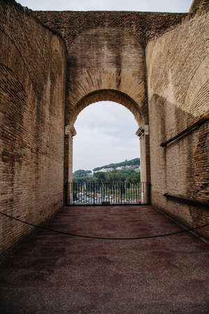 Rome city view through the arch of Colosseum. Rome, Italy,