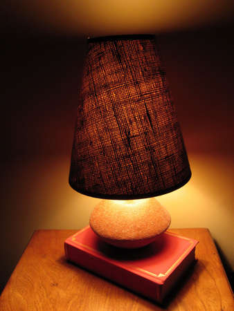 arcane: Turned on lamp on a little desk, alone against the darkness.