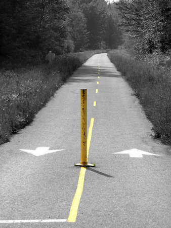 return trip: A grey road with yellow line on the middle. Stock Photo