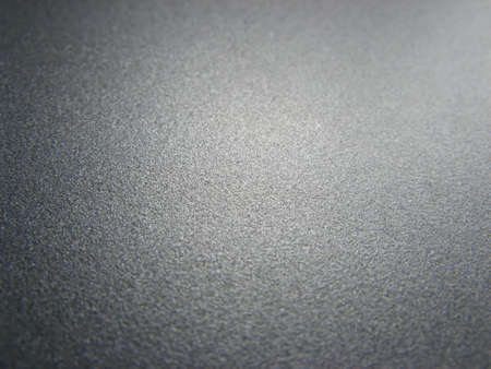 silvery: The lustrous paint of a laptop.