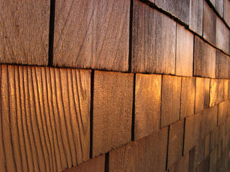 unyielding: A beautiful and solid wood wall under the light of a sunset.