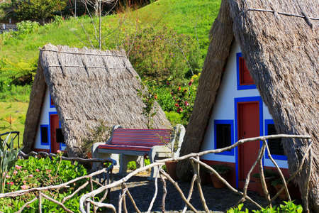 SANTANA, MADEIRA, PORTUGAL Traditional Madeira building with thatched roof. High quality photo