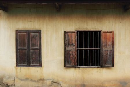 open windows: Old wooden windows open on a house wall in Chiang Mai,Thailand