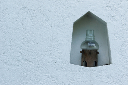 jag: Little lamp in a white wall