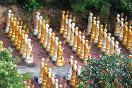 catacomb: golden statues at china temple in hatyai thailand