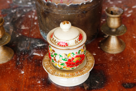 Among altar table in chinese temple photo