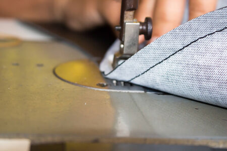 expertize: sewing machine in action for working leather Stock Photo