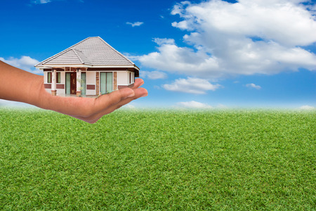 property for sale: House in hand, investment concept about the property. Stock Photo
