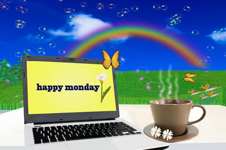 Notebook on white table with happy monday. photo