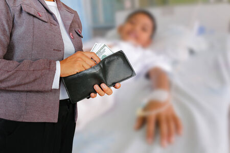 pay for: Women hold money to pay for treatment for his son. Stock Photo
