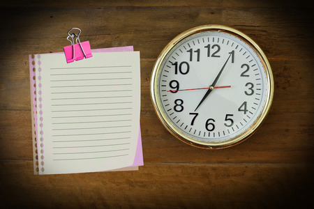 seven o'clock: The paper  with seven oclock hanging on the wooden wall. Stock Photo