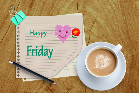 Happy Friday word and coffee cup on wooden background. photo