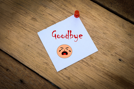 good bye: Good bye note paper  on a wooden background with cry face