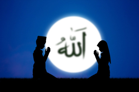light god: people praying to allah god of Islam on blue sky.The words spell is Allah means the God of Islam. Stock Photo
