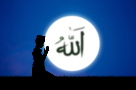 allah: people praying to allah god of Islam on blue sky.The words spell is Allah means the God of Islam. Stock Photo