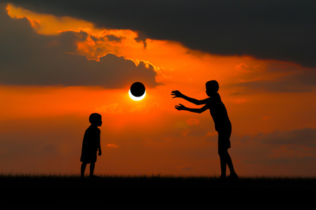 frolicking: Two brothers, boys play at sunset. Stock Photo