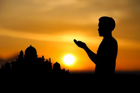 faith: people  praying at the sunset. Stock Photo