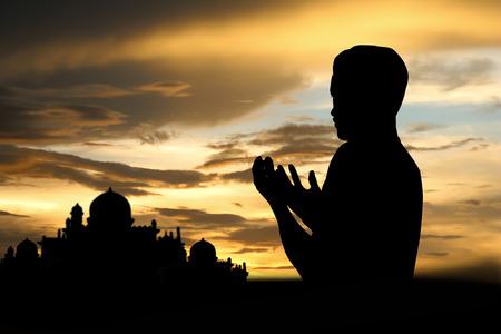 islamic pray: Silhouette muslim people  praying at sunset.