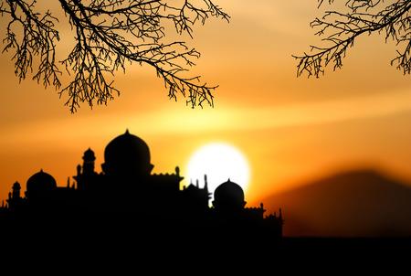 ramzaan: A silhouette of a mosque sunset background