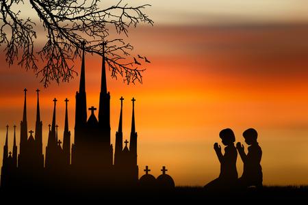 people  praying at the sunset. photo