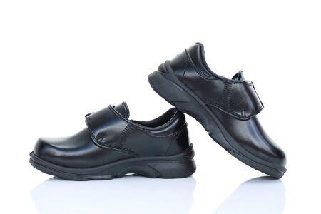 zapatos escolares: Zapatos del estudiante ni�o tailand�s en el fondo blanco.