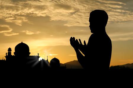 muslim: pepole praying to allah god of Islam on sunset. Stock Photo