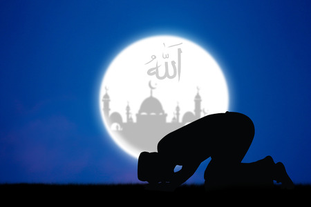 islamic pray: man praying to allah god of Islam .The words spell is Allah means the God of Islam