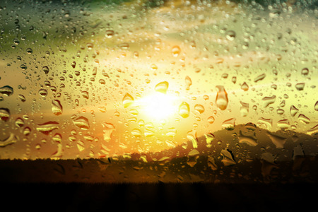 blurred bokeh and water drops on  mirror sunset  background Imagens