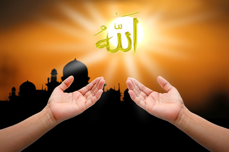 allah: Hands of peple praying to allah god of Islam on sunset.The words spell is Allah means the God of Islam.