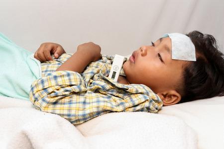 disease patients: a little boy who has fever.focus at a temperature.