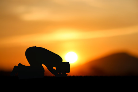 man praying to allah god of Islam on sunset Фото со стока - 42595576