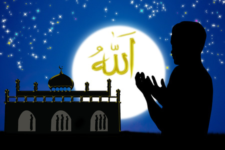 muslim celebration: man praying to allah god of Islam .The words spell is Allah means the God of Islam