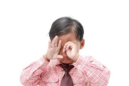 tearful: Little  boy crying. Isolated on white background