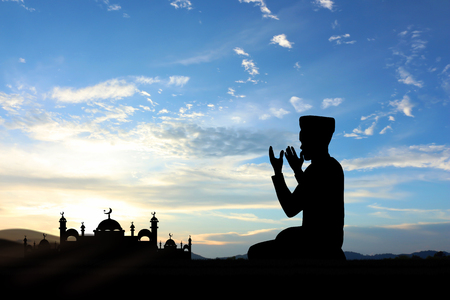 Silhouette muslim people  praying at sunset