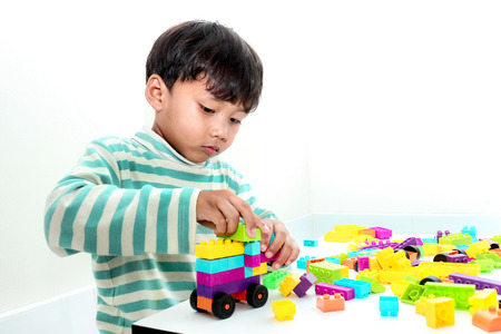 assiduous: Asian boy play with construction set in the room background. Stock Photo