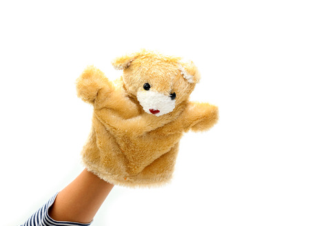 puppet: Hand puppet of bear for child on white background. Stock Photo