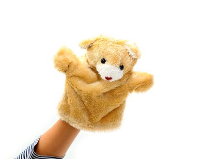 marioneta: Marioneta de mano del oso para el ni�o en el fondo blanco.