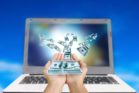 earn money: hand received dollar money,The concept earn money from technology .