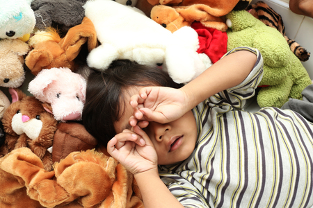 repose: Happy asian boy sleep and repose  in dolly. Stock Photo