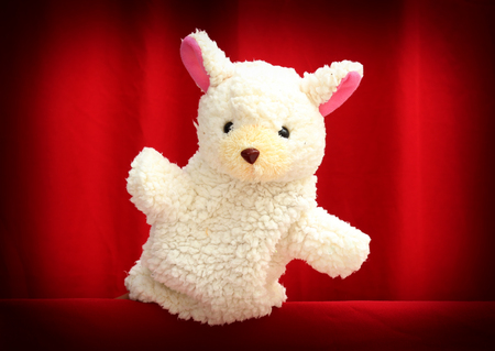 puppet: Hand puppet for child on red theatre background.