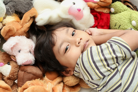 dolly: Happy asian boy  play and repose  in dolly. Stock Photo