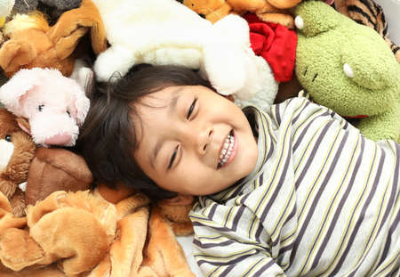 repose: Happy asian boy  play and repose  in dolly. Stock Photo