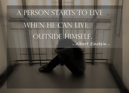 citations: Inspirational quote  by Albert Einstein on sunset  blurred background