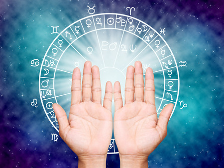 astral: Two open hands empty ,the horoscope concept.