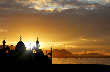 devout: A silhouette of a mosque at sunset.